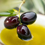 dipping-olive-sprig-with-black-olives-in-olive-oil-OKOK.jpg